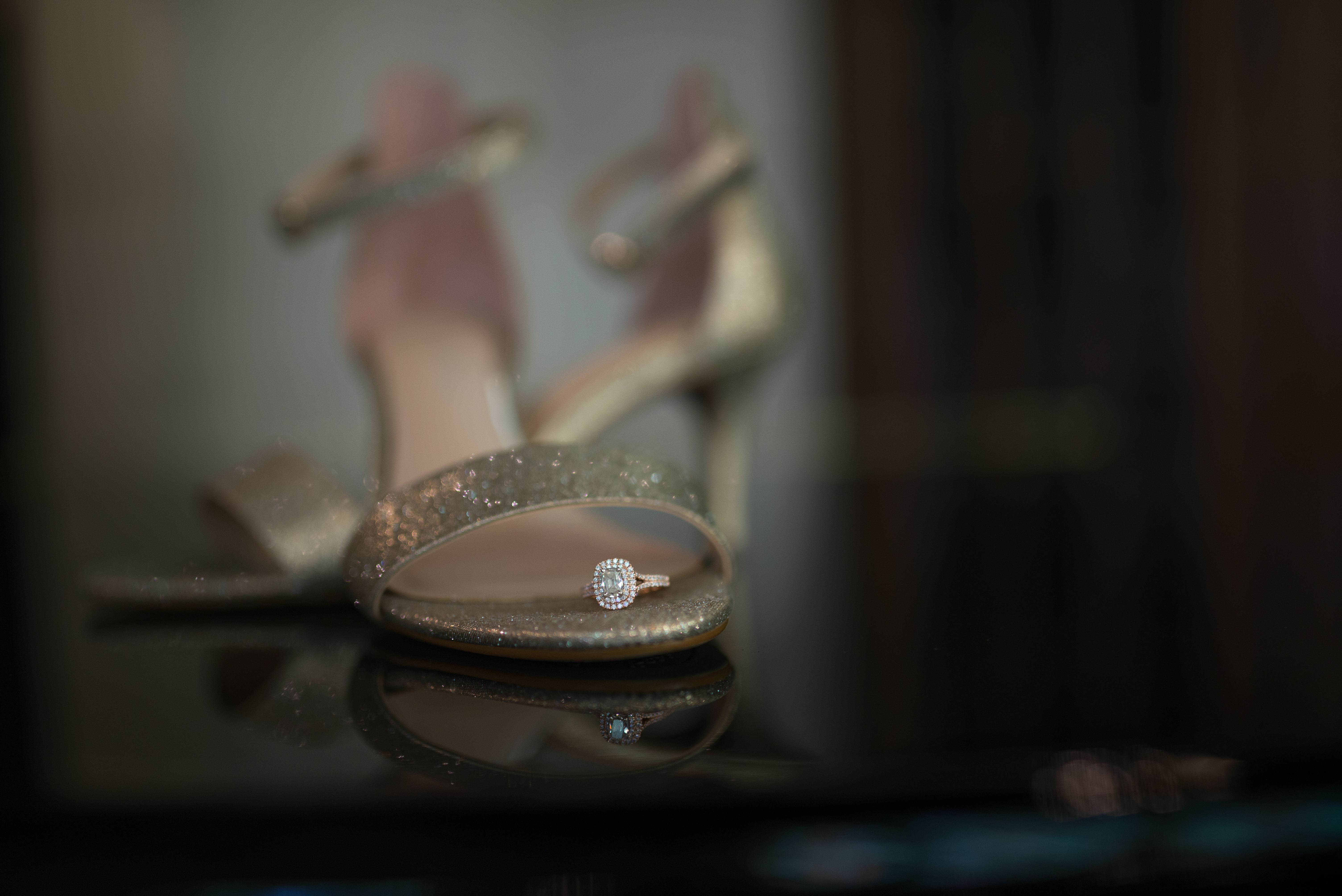 Bridal shoes with wedding ring at Patten Chapel by one of the best Chattanooga wedding photographers at Kim Nix photography