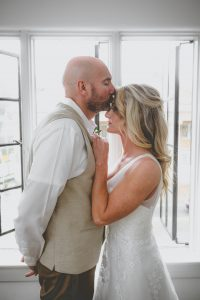 Couple kissing in Chattanooga wedding venue Scot & Haven; one of the best wedding photographers in Chattanooga tn