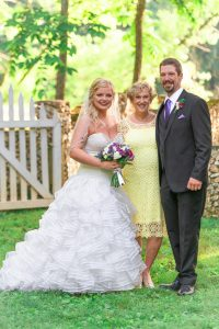 The best Cleveland photographer captures a beautiful shot of the bride and groom with the groom's mother.