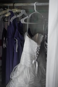 The dress hangs in the closet at wedding venue Fillauer Lake House in Cleveland TN
