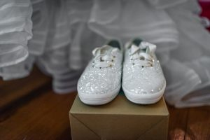 The shoes sit ready on the box they came in, soon they will be walking down the aisle at Fillauer Lake house!