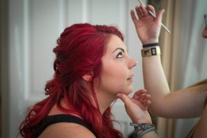 A Bridesmaid is getting her makeup done in Cleveland TN, by Chattanooga photographer Kim Nix