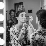 Bride puts her eyeliner on at patton Chapel, photograph by photographer Kim Nix.