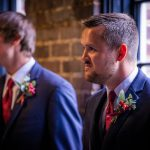 Groomsmen gathered in hallway at Chattanooga wedding venue, photographer Kim Nix in Chattanooga takes photograph.