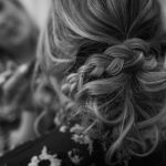 Bridesmaid hair is almost done, black and white photograph by Kim Nix Photography.