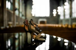 Chattanooga photographer photographs shoes on the piano at Patten Chapel, University of Tennessee