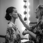 Black and white photograph of bride getting ready at patton Chapel by photographer Kim Nix