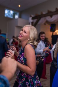Kim Nix, one of the best Chattanooga wedding photographers takes photographs of wedding guests dancing at The Venue, a Chattanooga Reception Hall