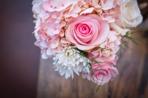 The best Chattanooga wedding photographer in tn photographs a bridal bouquet sitting on a table!